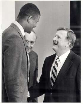1987: The post-George Gervin malaise continues as the Spurs lose 54 games in 1986-87, the most to date in San Antonio. But those losses translate into a huge victory in the draft lottery, where the Spurs beat 7-to-1 odds for the right to draft David Robinson. Express-News file photo of draft pick David Robinson (left) and Red McCombs (EXPRESS-NEWS FILE PHOTO)