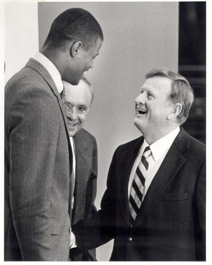 1987: The post-George Gervin malaise continues as the Spurs lose 54 games in 1986-87, the most to date in San Antonio. But those losses translate into a huge victory in the draft lottery, where the Spurs beat 7-to-1 odds for the right to draft David Robinson.Express-News file photo of draft pick David Robinson (left) and Red McCombs (EXPRESS-NEWS FILE PHOTO)