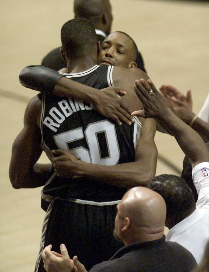 1990: The Spurs enjoy the biggest turnaround in NBA history, going from 21 wins in 1988-89 to 56 in 1989-90. Three additions key the revival: Terry Cummings, via trade; draftee Sean Elliott; and David Robinson, finally in uniform after his Naval tour ends. Kin Man Hui/Express-News (SAN ANTONIO EXPRESS NEWS)