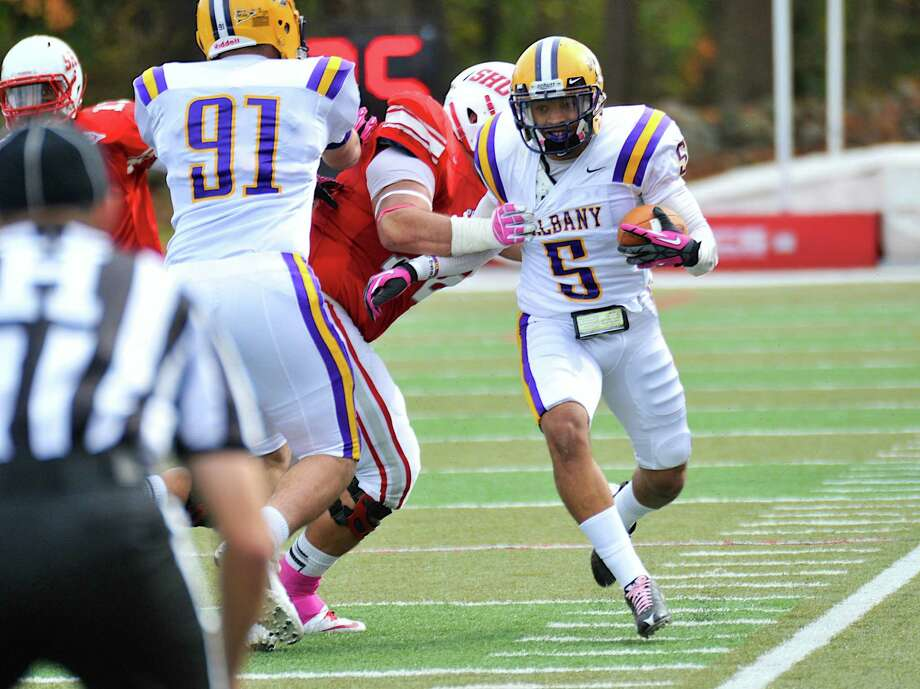 UAlbany's Tremaine Wilson returns an interception in the first half of Saturday's game vs.Sacred Heart.  UAlbany posted a closely contested 23-20 victory. (Bill Ziskin)