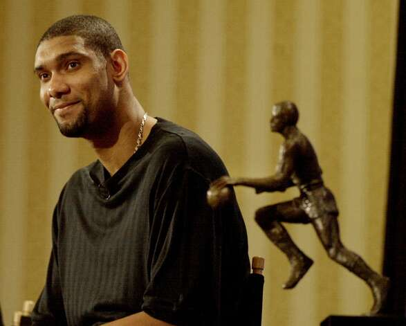 2003: Duncan wins his second straight MVP, becoming one of 14 players to win the award multiple times. Even more impressively, he does it at a time when his competition includes Shaquille O'Neal and Kevin Garnett, both of whom are at or near their peaks.  AP file photo (AP)