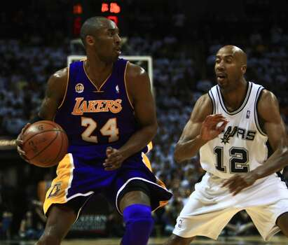 No. 12 Bruce Bowen - Widely regarded as one of the best perimeter defenders in the league. ..... earned first or second All-Defensive team honors from 2001-08. ..... three-time NBA champion. ..... three-point champion in 2002-03 (44.1 percent). ..... Spurs finished third or better in team defensive efficiency in seven of his eight seasons. William Luther/Express-News (SAN ANTONIO EXPRESS-NEWS)