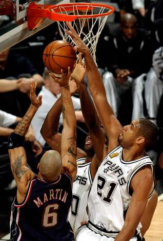 "No. 21 Tim Duncan - ""The Big Fundamental""..... guaranteed of Hall of Fame induction. ..... 13-time All-Star. ..... 1997-98 Rookie of the Year. ..... 2001-02 and 2002-03 MVP. ..... four-time NBA champion. ..... three-time NBA Finals MVP. ..... broke David Robinson's franchise records for career points (22,558) and rebounds (12,533). ..... 13-time All-Defense selection. William Luther/Express-News (SAN ANTONIO EXPRESS-NEWS)"
