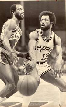 """No. 13 James Silas - """"Captain Late"""". ..... teamed with Gervin to form one of the best backcourts in professional basketball. ..... led the Spurs in scoring in 1975-76 (23.8 ppg), after which his career was derailed by a serious knee injury . ..... recovered to play six more seasons, averaging 16, 17.7 and 17.7 points during one stretch. ..... ABA All-Star in 1975 and 1976. Express-News file photo (FILE PHOTO)"""