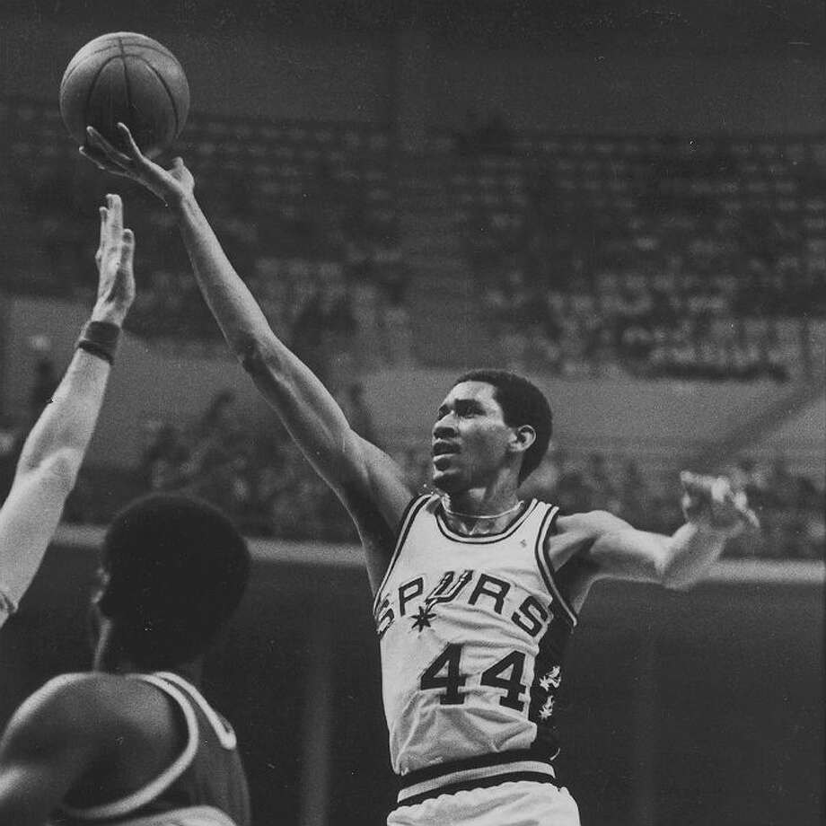 New Orleans Jazz 153, Spurs 132: 1977-78 regular season - George Gervin scores 63 in the final game of the season to edge David Thomson, 27.22 to 27.15 ppg, for the fi rst of his four scoring titles.  Express-News file photo of George Gervin from 1978