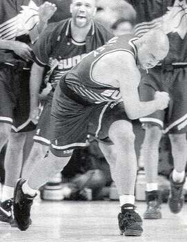 Phoenix Suns 102, Spurs 100: 1993 Western Conference semifinals - Charles Barkley's jump shot over David Robinson eliminates the Spurs in their final game at HemisFair Arena.  Express-News file photo