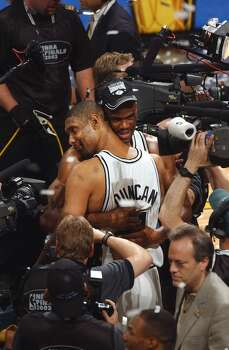 Spurs 88, New Jersey Nets 77: 2003 Finals - Tim Duncan caps perhaps his finest playoff series with 21 points, 20 rebounds, 10 assists and eight blocked shots in Game 6 for the Spurs' second title. William Luther/Express-News (SAN ANTONIO EXPRESS-NEWS)