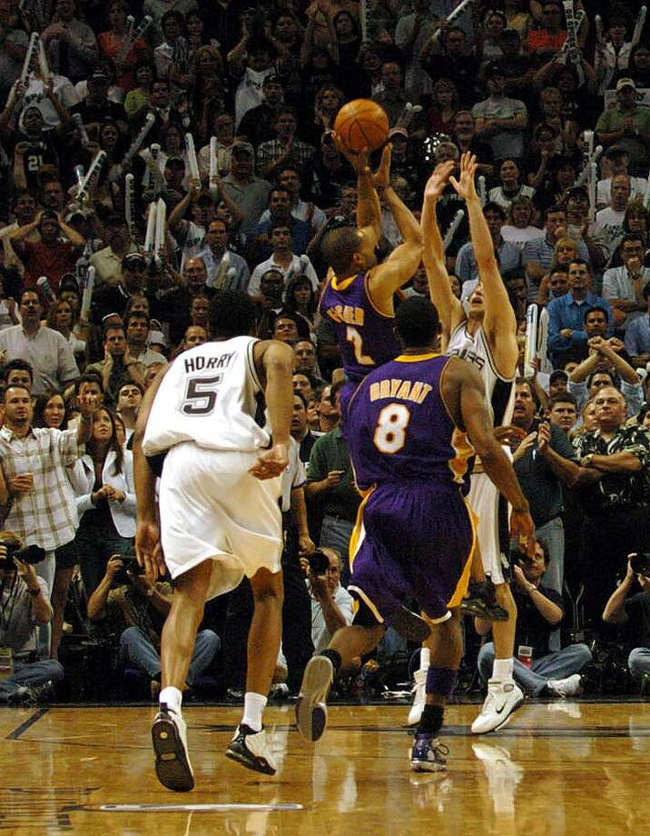 Los Angeles Lakers 74, Spurs 73: 2004 Western Conference semifinals - Despite an official protest by the Spurs, Derek Fisher's miraculous, off-balance jumper with 0.4 seconds left stands. Kin Man Hui/Express-News (SAN ANTONIO EXPRESS-NEWS)