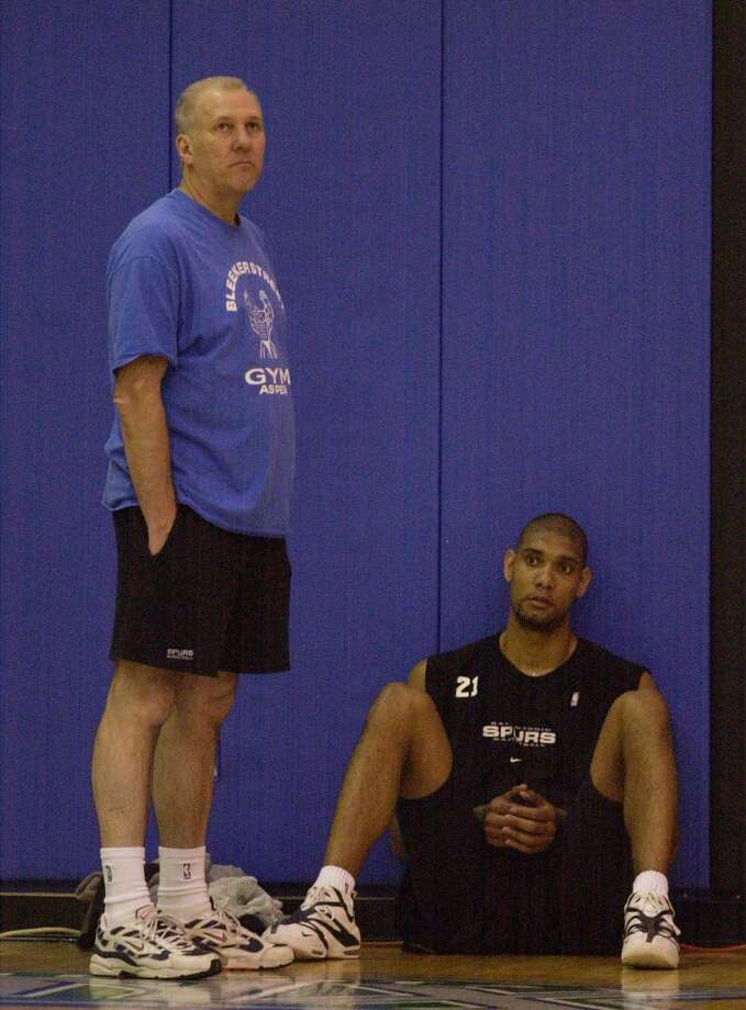 Spurs coach Gregg Popovich and forward Tim Duncan watch as their practice session wind down at the Target Center on Sunday, April 29, 2001 in Minneapolis, MN. (SAN ANTONIO EXPRESS-NEWS)