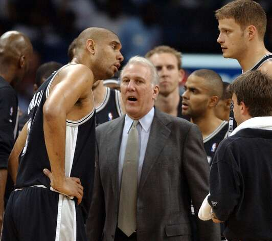Spurs' Tim Duncan talks with coach Gregg Popovich as Rasho Nesterovic listens during a timeout against the Grizzlies Sunday April 25, 2004 during Game 4, Round 1 of the 2004 NBA Playoffs at the Pyramid in Memphis, TN. The Spurs went on to win 110-97.  EDWARD A. ORNELAS/Express-News (SAN ANTONIO EXPRESS-NEWS)