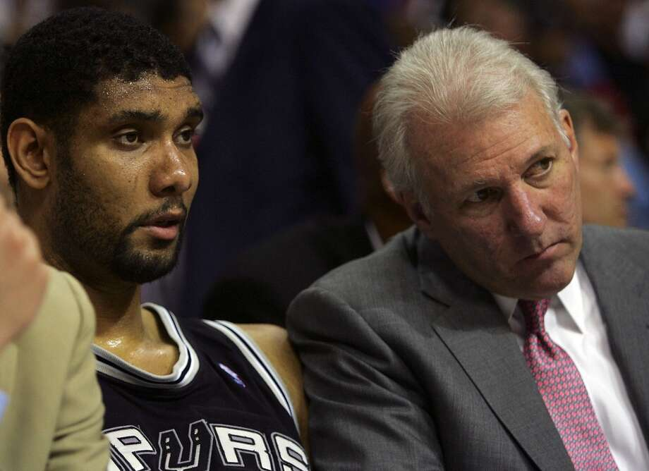 Spurs Tim Duncan and Gregg Popovich watch in disbelief during fourth quarter action as the Pistons blowout the Spurs 102-71 game four of the NBA Finals at The Palace of Auburn Hills on June 16, 2005.  JERRY LARA/Express-News (SAN ANTONIO EXPRESS-NEWS)