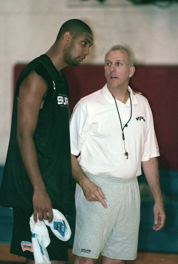 Tim Duncan and Coach Gregg Popovich talk after the first day of training camp for the Spurs, Saturday October 2,1999. (Express-News)