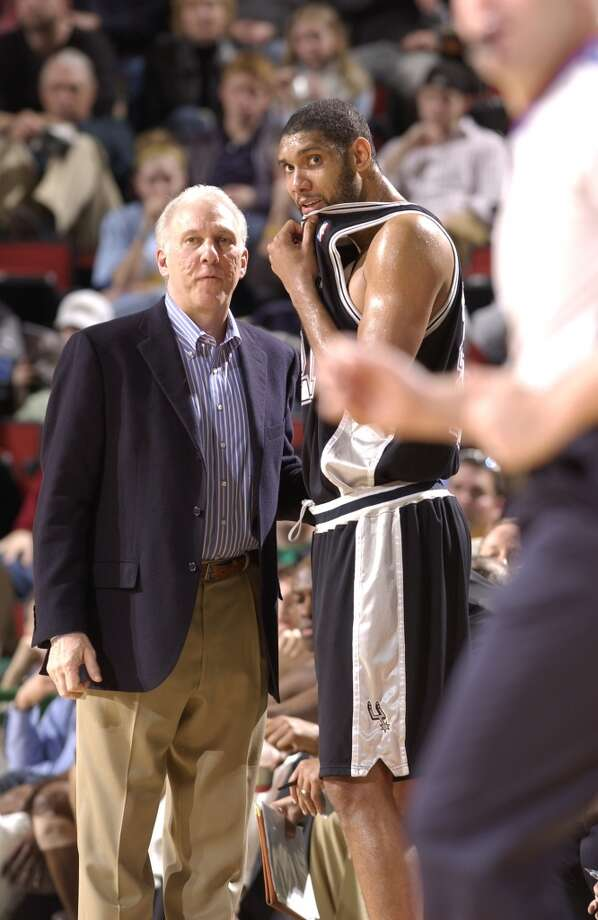 Spurs coach Greg Popovic talks with Tim Duncan in the game against the Seattle SuperSonics on March 25, 2007 at the Key Arena in Seattle, Washington. Photo by Terrence Vaccaro/NBAE via Getty Images (NBAE/Getty Images)