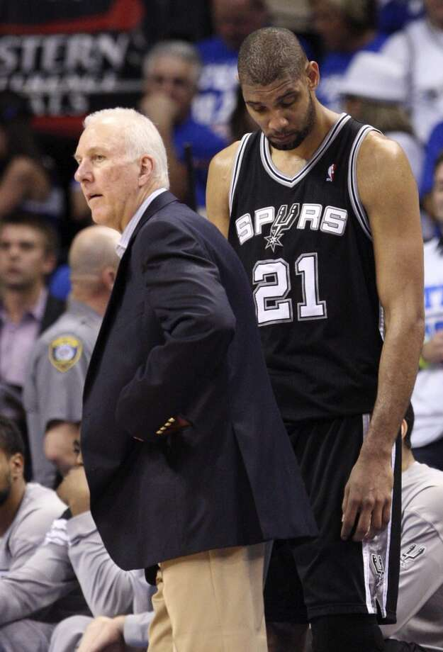 Spurs coach Gregg Popovich stands near Tim Duncan (21) during the second half of game four of the NBA Western Conference Finals in Oklahoma City, Okla. on Saturday, June 2, 2012. The Thunder won 109-103. (Edward A. Ornelas / San Antonio Express-News)