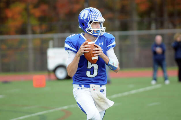Darien's Henry Baldwin throws as Darien High School hosts Staples in a football game in Darien, Conn., Oct. 27, 2012. Photo: Keelin Daly