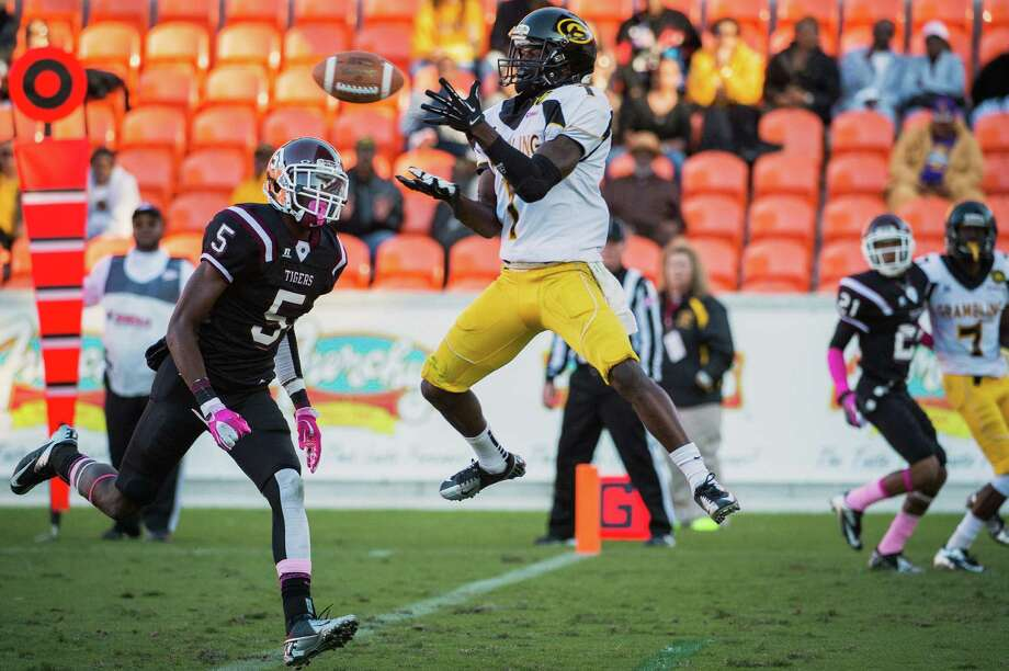 Grambling wide receiver Anthony McGhee (1) catches a 16-yard touchdown pass as Texas Southern defensive back Tray Walker (5) defends during the second quarter. Photo: Smiley N. Pool, Houston Chronicle / © 2012  Houston Chronicle