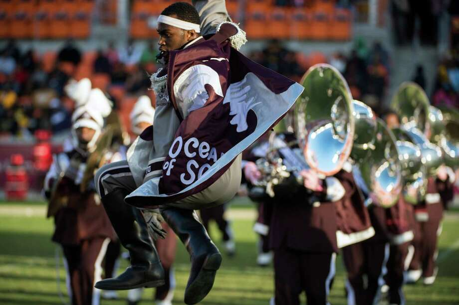 "Drum major Trevor Moore performs with The Texas Southern University ""Ocean of Soul"" marching band at halftime of a college football game at against Grambling. Photo: Smiley N. Pool, Houston Chronicle / © 2012  Houston Chronicle"