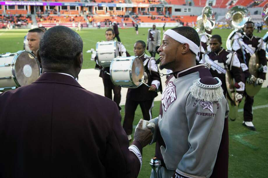"Drum major Darius Harris leads the Texas Southern University ""Ocean of Soul"" marching band shakes hands with director Richard Lee after the band performed at halftime of a college football game at against Grambling. Photo: Smiley N. Pool, Houston Chronicle / © 2012  Houston Chronicle"