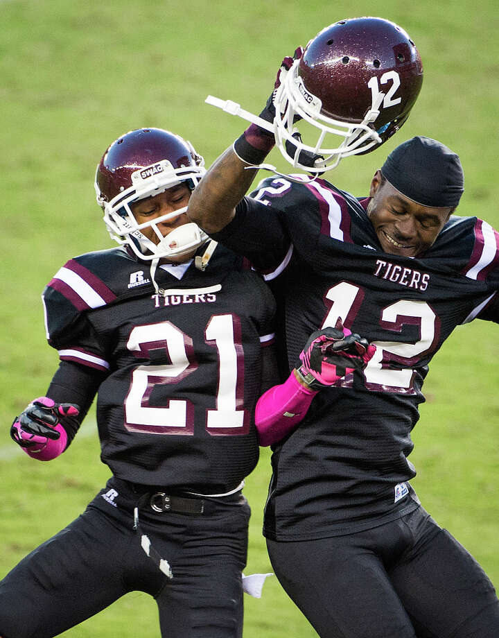 Texas Southern linebacker Eric Brown (12) celebrates with defensive back Alexander Kelly (21) after he intercepted a pass and returned it for a touchdown during the fourth quarter. Photo: Smiley N. Pool, Houston Chronicle / © 2012  Houston Chronicle