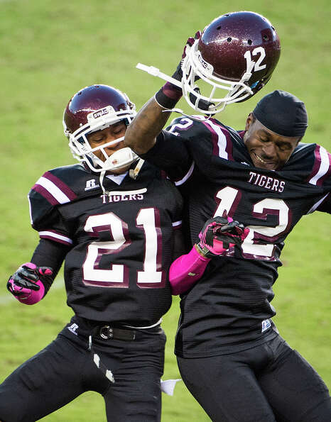 Texas Southern linebacker Eric Brown (12) celebrates with defensive back Alexander Kelly (21) after