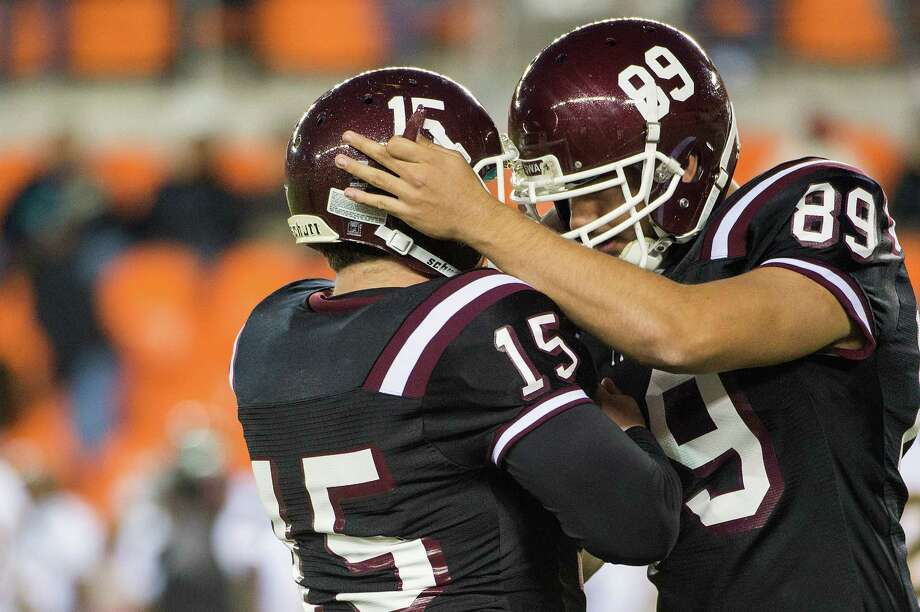 Texas Southern kicker Robert Hersh celebrates with Zachary Faires (89) after kicking a 31-yard field goal to give TSU a 23-20 advantage. Photo: Smiley N. Pool, Houston Chronicle / © 2012  Houston Chronicle