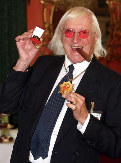 A year after BBC's Jimmy Savile died at age 84, honored with knighthood and a papal honor for his charity work, several women have come forward to claim he was a sexual predator. Photo: Lewis Whyld, SUB / PA