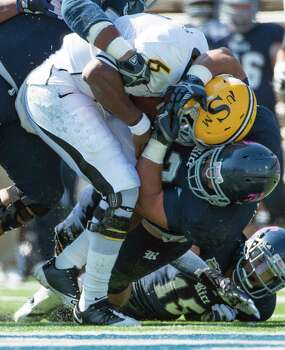 Southern Miss quarterback Arsenio Favor (6) is sacked by Rice defensive tackle Christian Covington (56) as cornerback Phillip Gaines (15) comes in on the play during the first half. Photo: Smiley N. Pool, Houston Chronicle / © 2012  Houston Chronicle