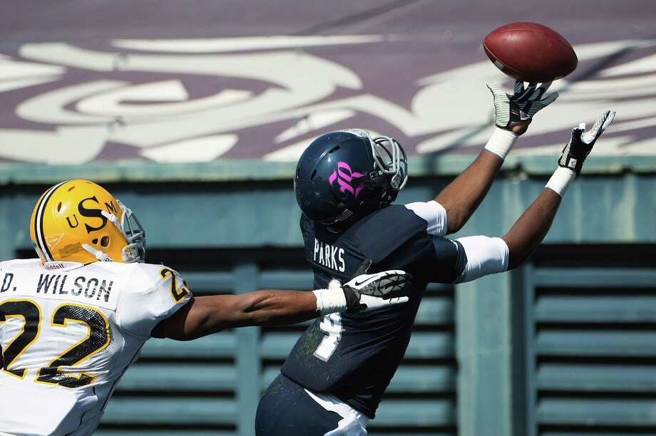 Rice wide receiver Dennis Parks (4) catches a 35-yard touchdown pass as Southern Miss defensive back Deron Wilson (22) defends during the first quarter. Photo: Smiley N. Pool, Houston Chronicle / © 2012  Houston Chronicle