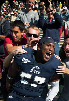 Rice linebacker Cameron Nwosu celebrates with fans following a 44-17 victory over Southern Miss. Photo: Smiley N. Pool, Houston Chronicle / © 2012  Houston Chronicle