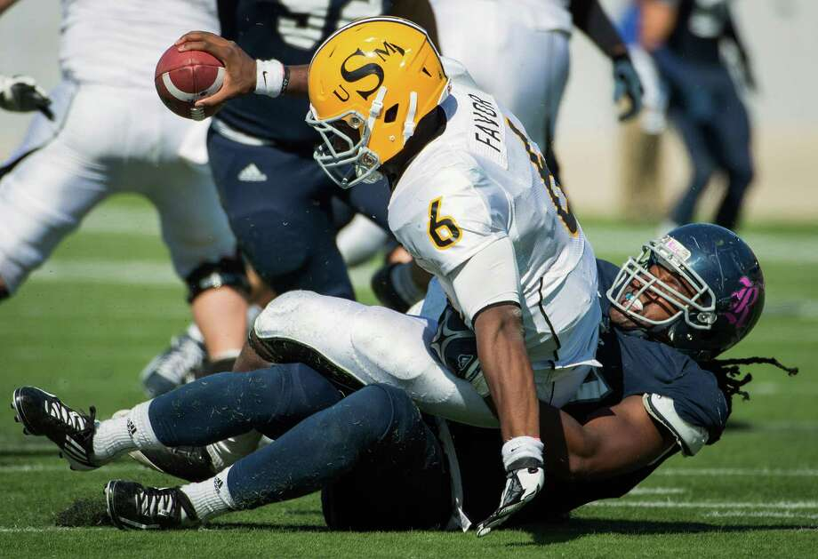 Southern Miss quarterback Arsenio Favor (6) is sacked by Rice defensive end Jared Williams (97) during the fourth quarter. Photo: Smiley N. Pool, Houston Chronicle / © 2012  Houston Chronicle