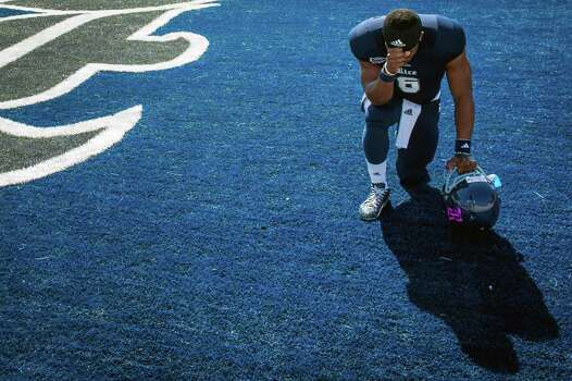 Rice quarterback Driphus Jackson kneels in prayer before an NCAA college football game against Southern Miss at Rice Stadium. Photo: Smiley N. Pool, Houston Chronicle / © 2012  Houston Chronicle