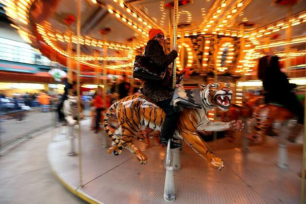 A fan of the Detroit Tigers rides a carousel at the ballpark prior to the Tigers playing the San Francisco Giants during Game Three of the Major League Baseball World Series at Comerica Park on October 27, 2012 in Detroit, Michigan. Photo: Ezra Shaw, Getty Images