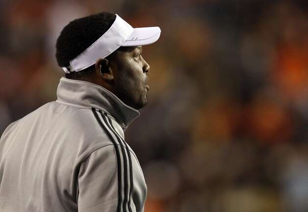 Texas A&M Coach Kevin Sumlin calls in a play from the sideline during the first half of an NCAA college football game against Auburn, Saturday, Oct. 27, 2012, in Auburn, Ala. (AP Photo/Butch Dill) (Associated Press)