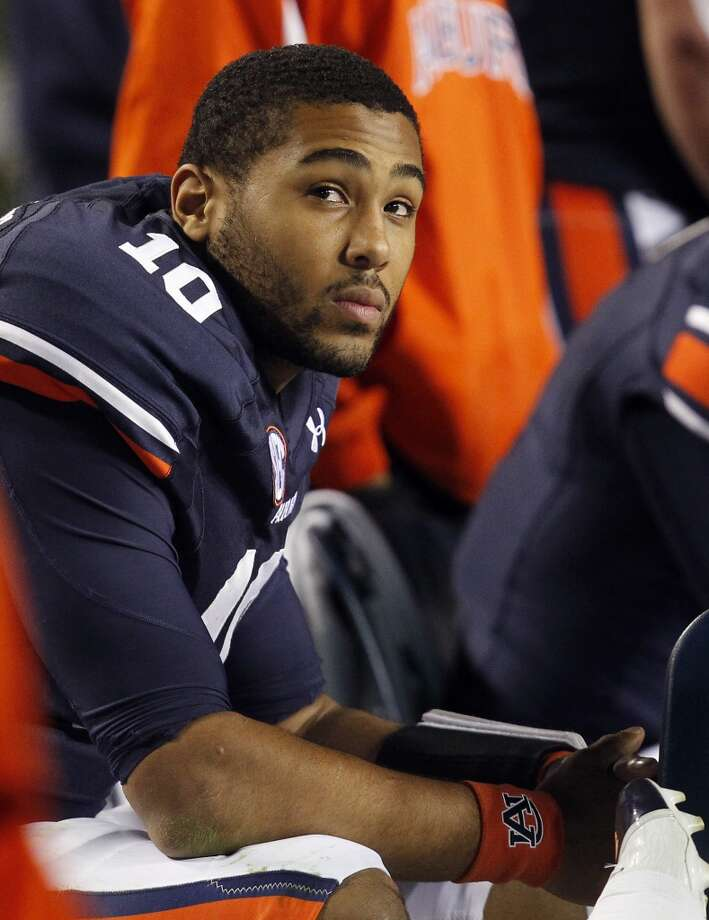 Auburn quarterback Kiehl Frazier (10) looks at the scoreboard as Texas A&M puts up another score during the second half of an NCAA college football game on Saturday, Oct. 27, 2012, in Auburn, Ala. (AP Photo/Butch Dill) (Associated Press)