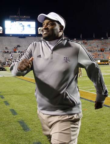 Texas A&M coach Kevin Sumlin runs off the field after defeating Auburn 63-21 in an NCAA college football game on Saturday, Oct. 27, 2012, in Auburn, Ala. (AP Photo/Butch Dill) (Associated Press)