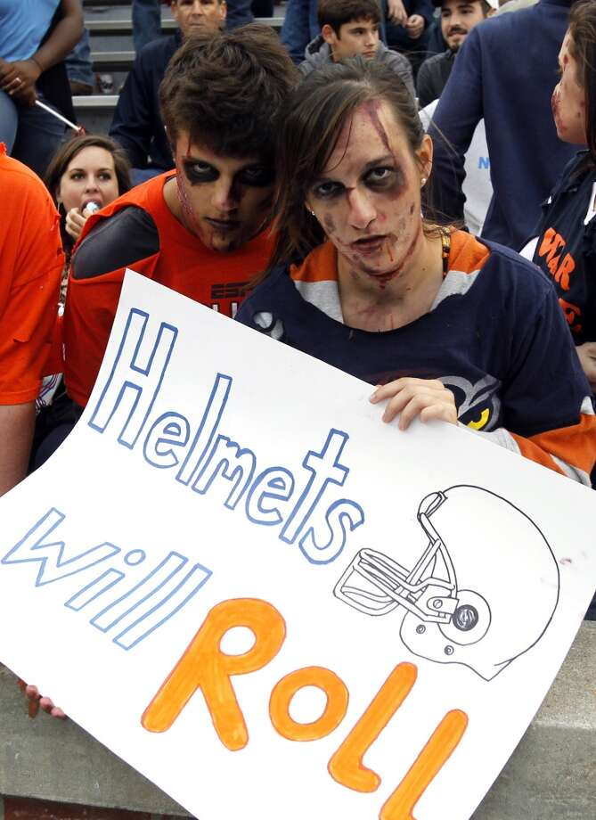 Auburn fans dress for Halloween before an NCAA college football game against Texas A&M, Saturday, Oct. 27, 2012, in Auburn, Ala. (AP Photo/Butch Dill) (Associated Press)