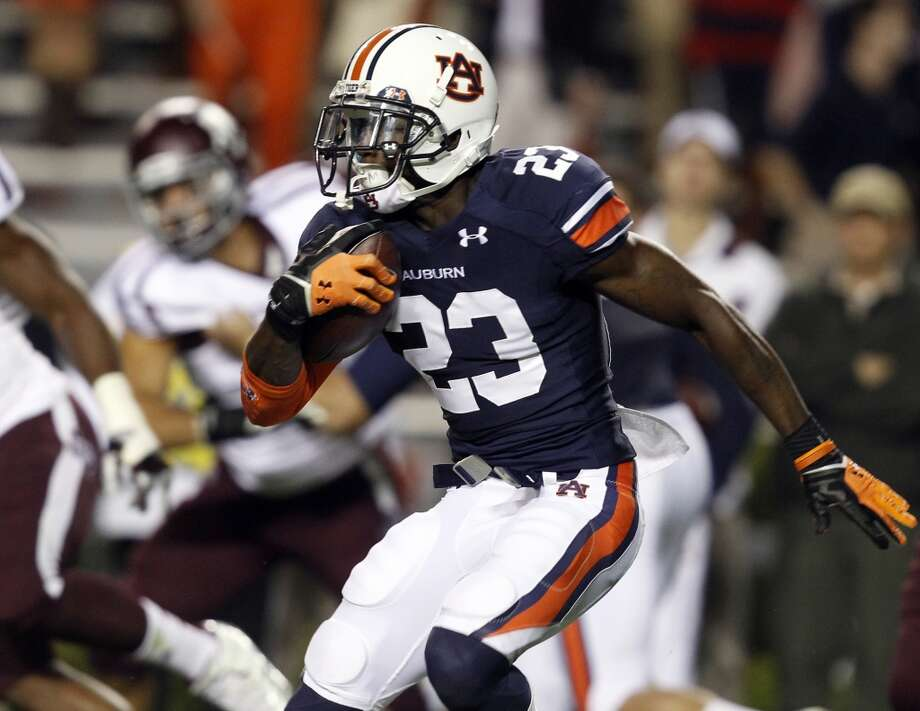 Auburn running back Onterio McCalebb (23) finds some running room on a kick return against Texas A&M during the second half of an NCAA college football game on Saturday, Oct. 27, 2012, in Auburn, Ala. (AP Photo/Butch Dill) (Associated Press)