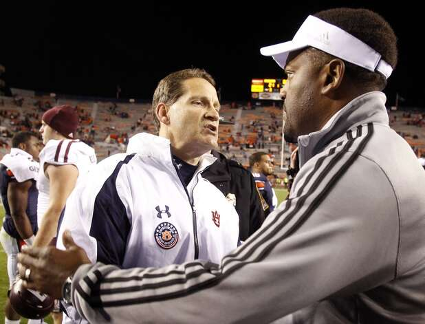Auburn coach Gene Chizik, left,shakes hands with Texas A&M coach Kevin Sumlin after Texas A&M defeated Auburn 63-21 in an NCAA college football game on Saturday, Oct. 27, 2012, in Auburn, Ala. (AP Photo/Butch Dill) (Associated Press)