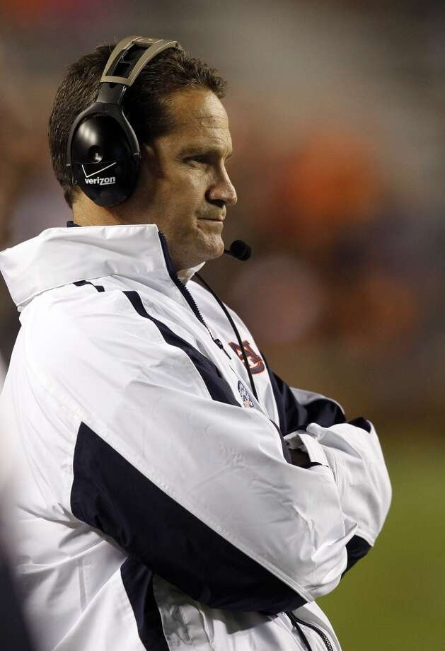 Auburn coach Gene Chizik watches from the sidelines as Texas A&M scores another touchdown during the second half of an NCAA college football game on Saturday, Oct. 27, 2012, in Auburn, Ala. (AP Photo/Butch Dill) (Associated Press)