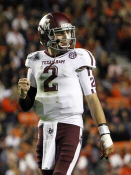 Texas A&M quarterback Johnny Manziel (2) celebrates after his team scored a touchdown against Auburn during the second half of an NCAA college football game on Saturday, Oct. 27, 2012, in Auburn, Ala. (AP Photo/Butch Dill) (Associated Press)