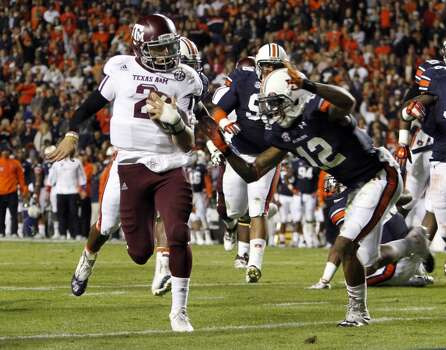Texas A&M quarterback Johnny Manziel (2) runs in for a touchdown past Auburn defensive back Demetruce McNeal (12) during the first half of an NCAA college football game on Saturday, Oct. 27, 2012, in Auburn, Ala. (AP Photo/Butch Dill) (Associated Press)