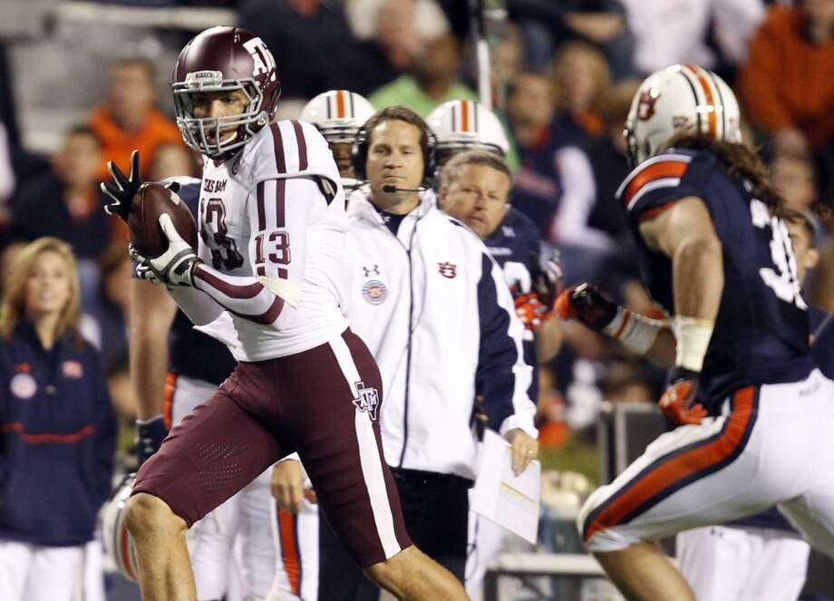 Texas A&M wide receiver Mike Evans (13) catches a pass for a first down over Auburn linebacker Cassanova McKinzy (30) during the second half of an NCAA college football game on Saturday, Oct. 27, 2012, in Auburn, Ala. (AP Photo/Butch Dill) (Associated Press)