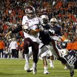 Texas A&M quarterback Johnny Manziel (2) runs in for a touchdown past Auburn defensive back Demetruce McNeal during the first half of an NCAA college football game on Saturday, Oct. 27, 2012, in Auburn, Ala. (AP Photo/Butch Dill) (Associated Press)