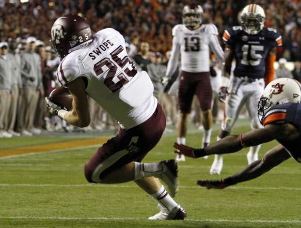 Texas A&M wide receiver Ryan Swope (25) catches a pass for a touchdown past Auburn defensive end Craig Sanders (13) during the first half of an NCAA college football game on Saturday, Oct. 27, 2012, in Auburn, Ala. (AP Photo/Butch Dill) (Associated Press)