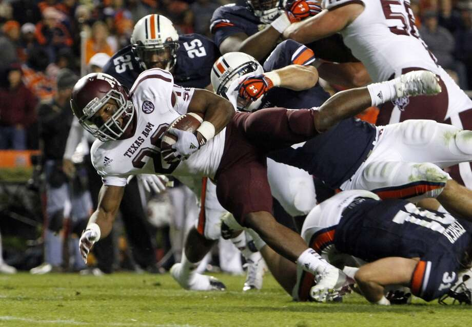 Texas A&M running back Trey Williams (20) stretches for the end zone but comes up short as he is tackled by Auburn linebacker Jake Holland (5) during the second half of an NCAA college football game on Saturday, Oct. 27, 2012, in Auburn, Ala. (AP Photo/Butch Dill) (Associated Press)