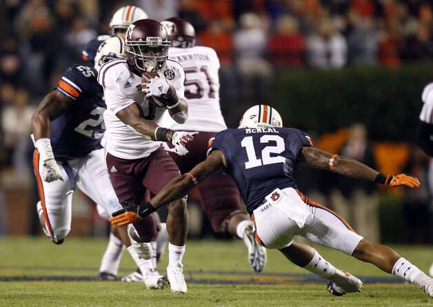 Texas A&M running back Ben Malena (1) tries to get around Auburn defensive back Demetruce McNeal (12) during the first half of an NCAA college football game on Saturday, Oct. 27, 2012, in Auburn, Ala. Texas A&M defeated Auburn 63-21. (AP Photo/Butch Dill) (Associated Press)