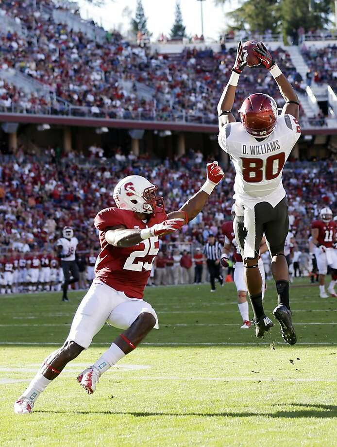 Washington State wide receiver Dominique Williams (80) makes a 43-yard catch next to Stanford cornerback Alex Carter during the first half of an NCAA college football game in Stanford, Calif., Saturday, Oct.  27,  2012. (AP Photo/Marcio Jose Sanchez) Photo: Marcio Jose Sanchez, Associated Press