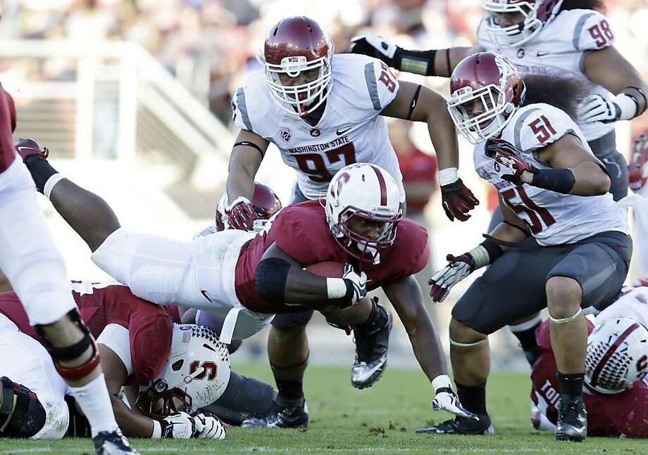 Stanford tailback Stepfan Taylor (center) was held to a season-low 58 rushing yards by Washington State. Photo: Marcio Jose Sanchez, Associated Press