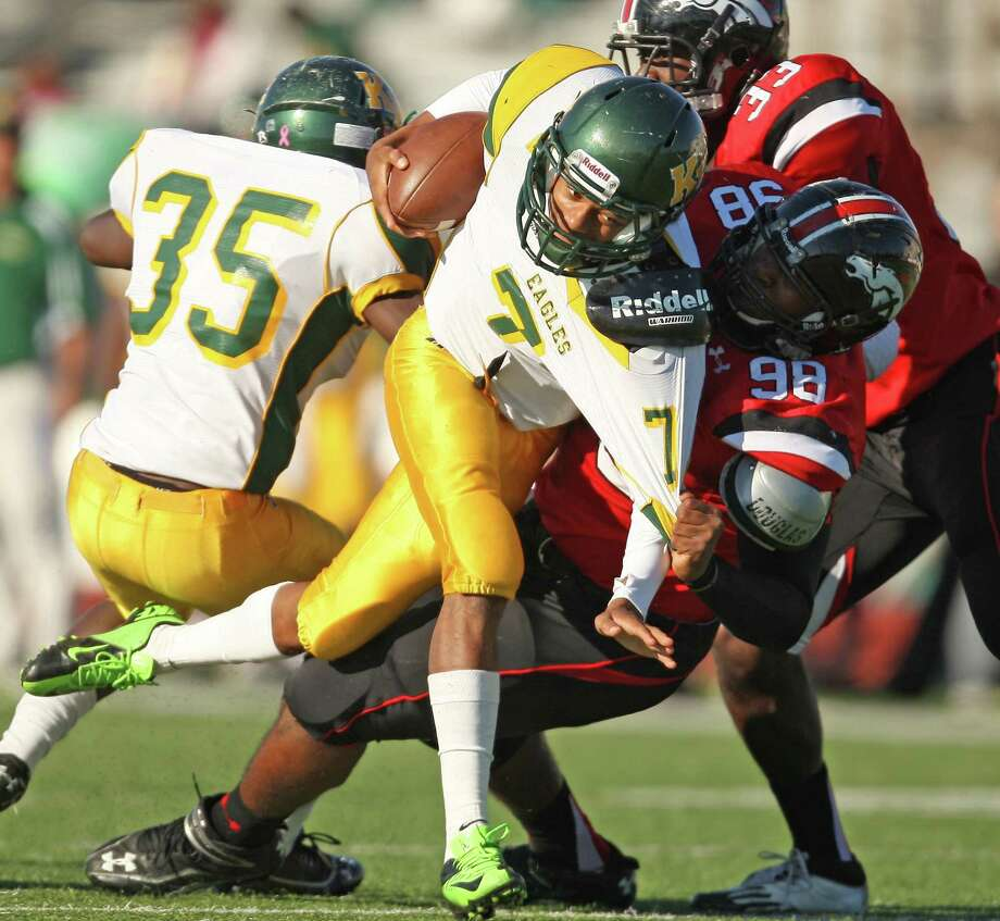Westfield's Hardreck Walker (98) collars Klein Forest quarterback DeAndre Harris (7) - one of four sacks by the Mustangs' defense Saturday. Photo: Eric Christian Smith, Freelance