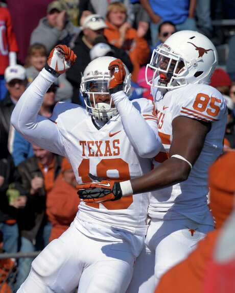 Texas' D.J. Grant, left, and M.J. McFarland rejoice after Grant's go-ahead touchdown reception with 12 seconds remaining. Photo: Reed Hoffmann, FRE / FR48783 AP